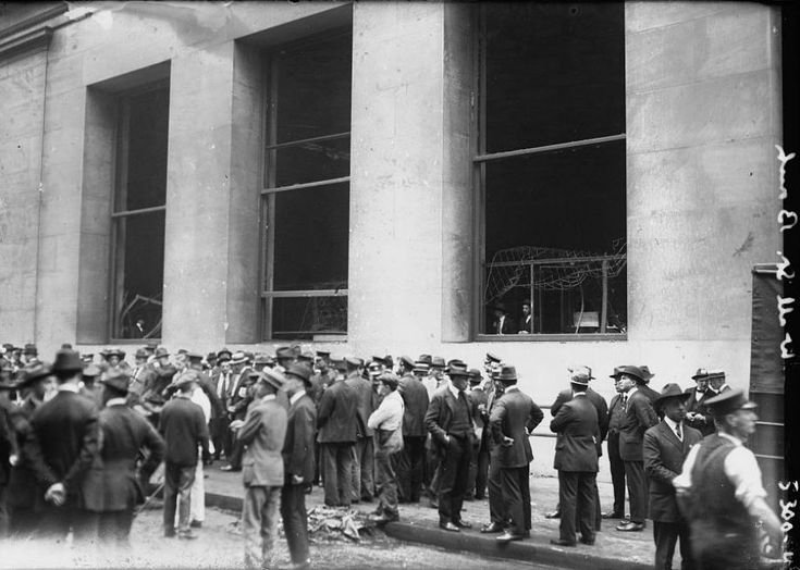 The Wall Street bombing, as the event is now known, occured just after noon on Thursday, September 16, 1920. A wagon loaded with a bomb containing dynamite and 500 pounds of small iron weights parked in front of 23 Wall Street. The corner building was then the headquarters of J.P. Morgan & Co., the nation's most powerful bank. At 12:01 pm, the timer on the bomb reached zero and a terrific explosion rocked the street.