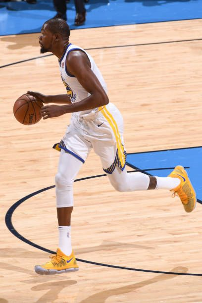 Kevin Durant of the Golden State Warriors moves up the court against the Oklahoma City Thunder during the game at the Chesapeake Energy Arena on...