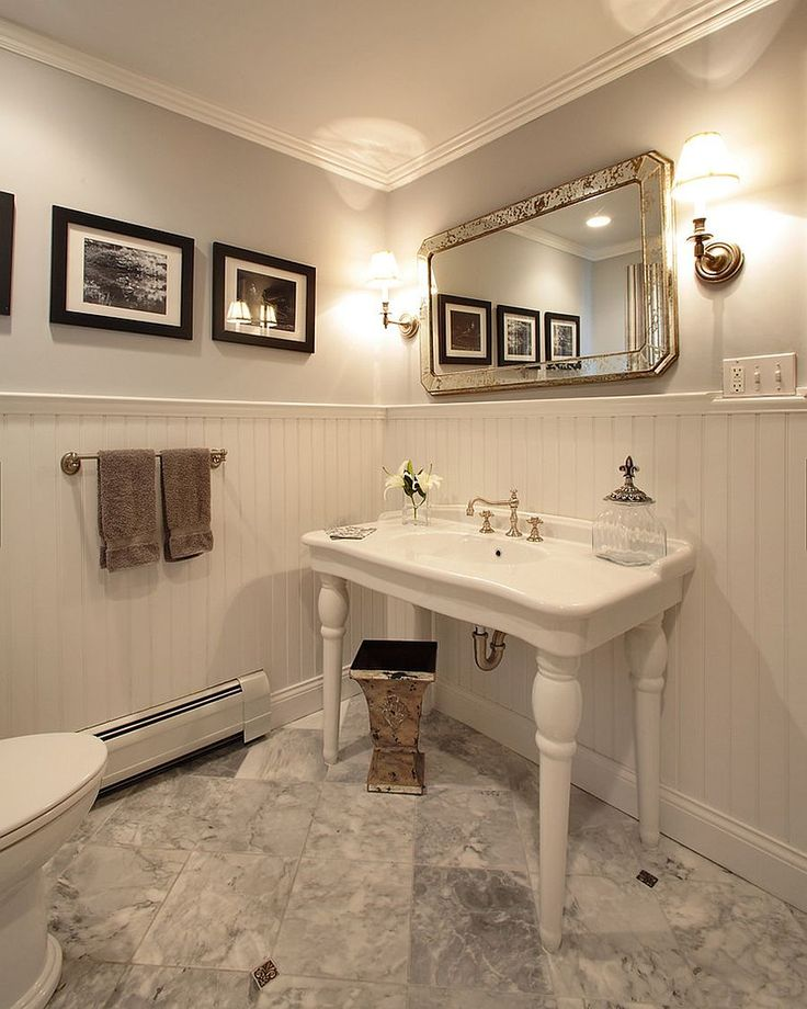 Beautiful traditional powder room in white with a dash of black [From: Olga Adler]