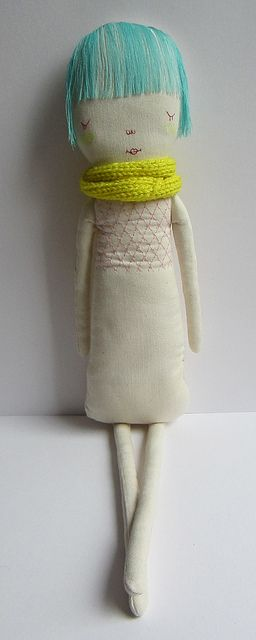 embroidered doll with knitted scarf, by marina*R Very simple, yet pleasing.