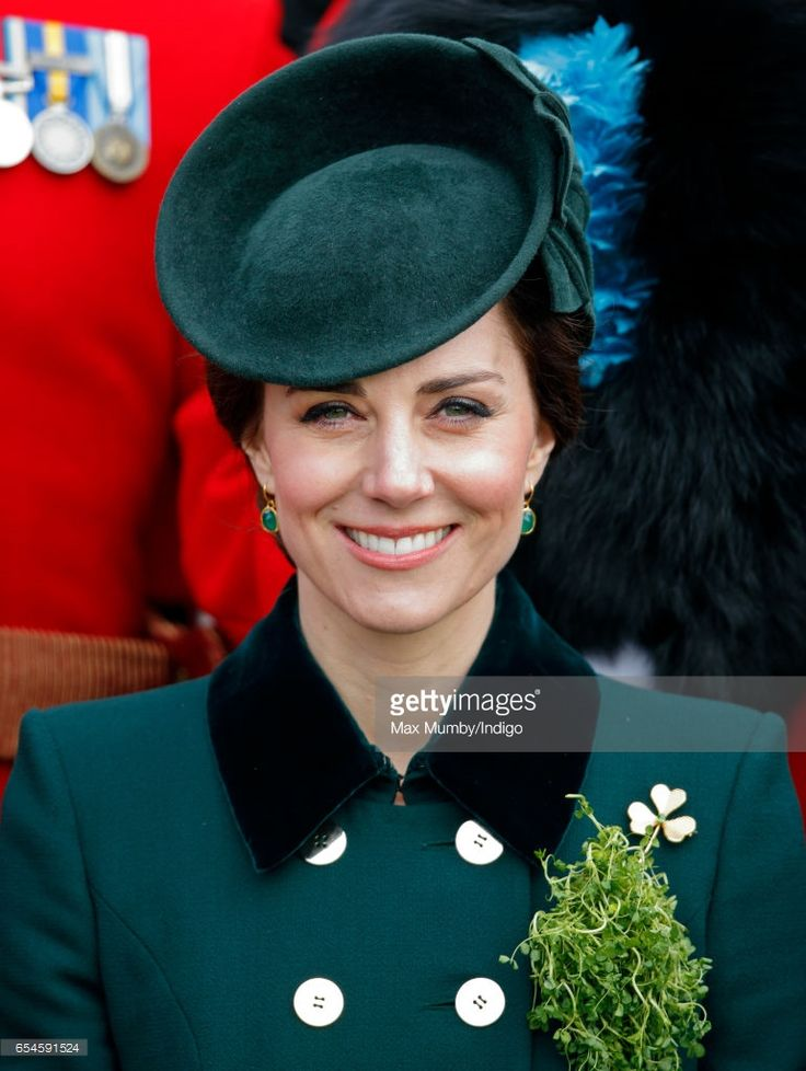 Catherine, Duchess of Cambridge poses for a regimental photograph with soldiers of the Irish Guards during the annual St Patrick's Day Parade at Cavalry Barracks on March 17, 2017 in London, England. Designer: Silvia Fletcher for Lock and Co. - Royal Hats