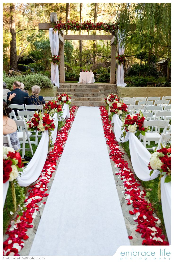Red and white wedding ceremony flowers by Floral Fields of Burbank, CA.