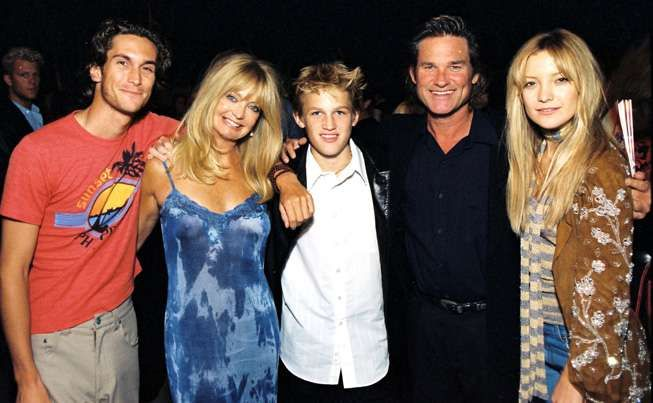 Goldie Hawn and Kurt Russell pose in 2000 with their brood of young actors: Oliver Hudson, who now stars in the sitcom Rules of Engagement; Wyatt Russell, who has done film work; and Kate Hudson, made famous by her performance in Almost Famous.