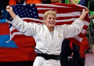 Kayla Harrison wins first American judo gold ever    Kayla's emotions when she received the gold medal are what it TRULY means to be an American. Stone faced during the whole competition, crying with joy and pride on the stand, singing our national anthem. This was for me the most heart warming moment of the Olympics for far. You rock Kayla!