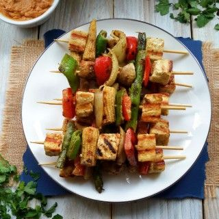 Mixed vegetables marinated in a delicious coconut-curry-lime sauce then grilled up and served with peanut sauce. A great plant-based vegan appetizer or finger food for your next party!