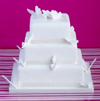 white butterfly tiered wedding cake