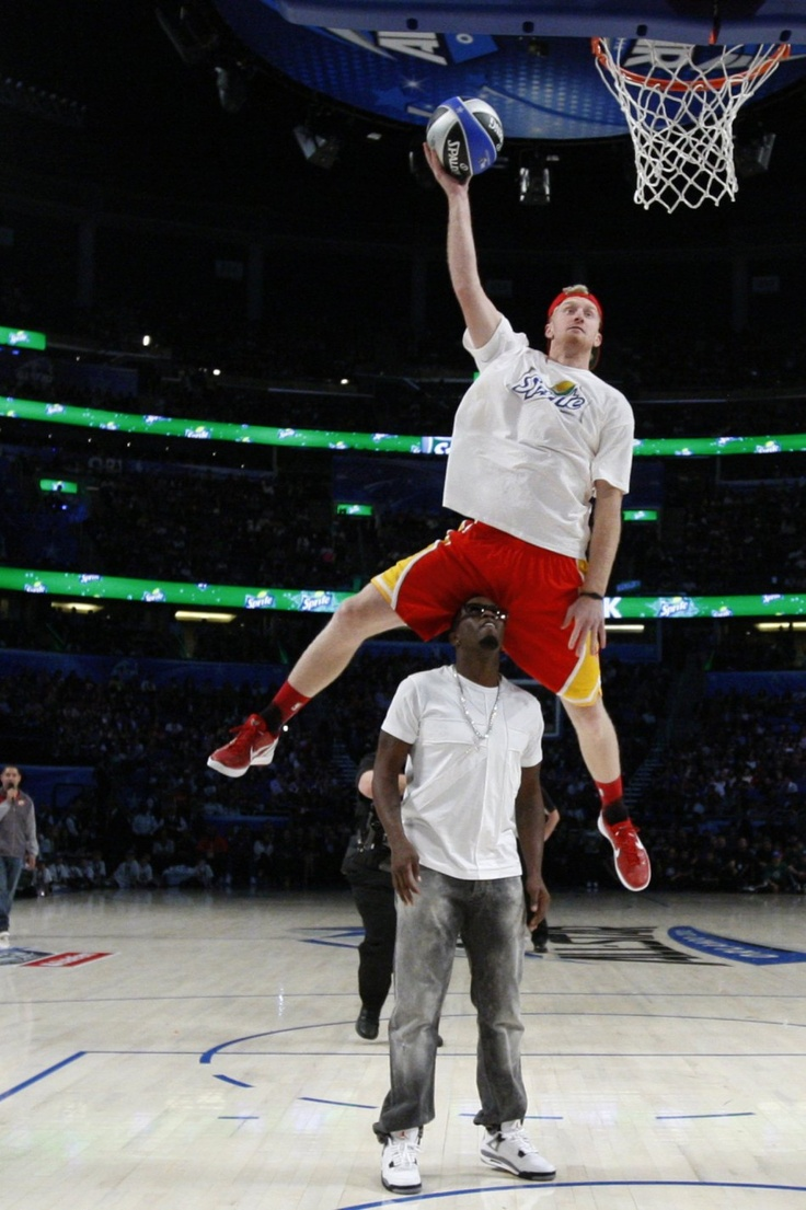 Who says white men can't jump? Chase Budinger jumps over P. Diddy during Sprite's 2012 Dunk Contest.