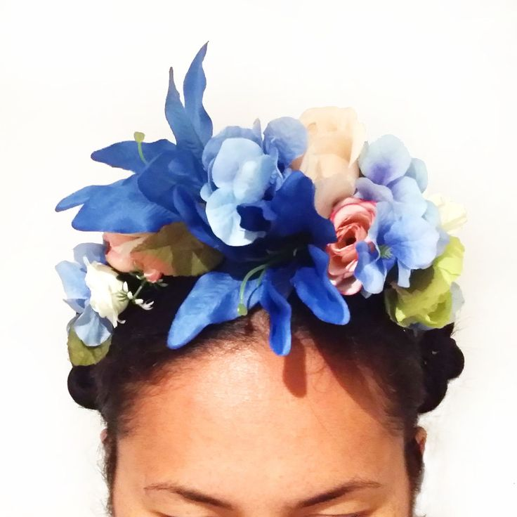 I have succumbed to the Frida Kahlo hair style (just because she is COOL) and have made these in the still of the weekend night!GO BIG OR GO HOME! A few less flowers but bigger and bolder then ever...Made with artificial paper and fabric flowers, with ribbon tying all in. HOORAY you can wear it more then once.. actually forever.Shades of Blue Rhododendron / White Crysanthemum