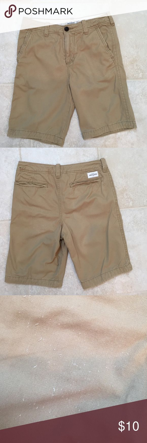 Abercrombie Kids khaki shorts boys size 16 Abercrombie Kids boys size 16 khaki shorts.  Slight wear on back of one leg that I never noticed till after I took picture.  There is a picture that shows what looks like a few little snags of the lighter color thread.  Price reflects the condition.  Shorts are still in great condition.  Thick 100% cotton. abercrombie kids Bottoms Shorts