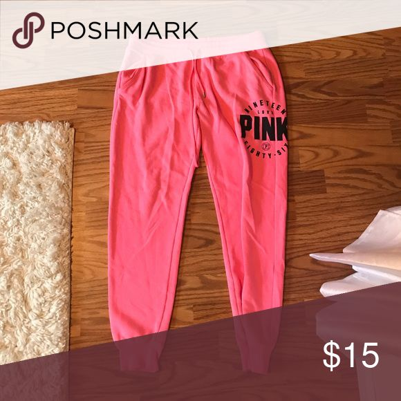 Victoria's Secret PINK neon pink sweatpants Super comfy and loose, has some wear between the thighs PINK Pants Track Pants & Joggers