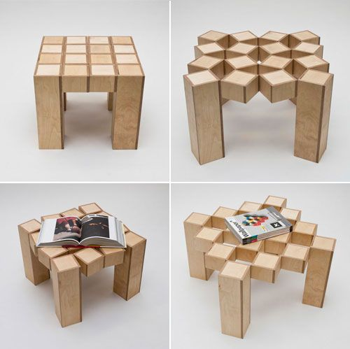 functionalism... this coffee table represents functionalism because it functions first as a small table, but then extends at will to accomodate bigger things to be sat upon it, without falling through the holes, of course...