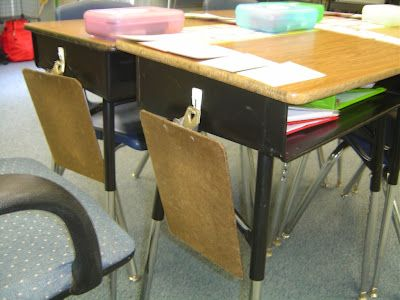 If you have desks you can store clipboards on the side for easy access.