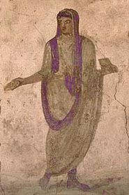 Men of the equestrian class were entitled to wear a tunic with narrow stripes, in the color the Romans called purple but was more like a deep crimson, extending from shoulder to hem, while broad stripes distinguished the tunics of men of the senatorial class. Most ancient statues do not show these stripes, but this wall painting from a lararium in Pompeii depicts both the tunica laticlavia and toga praetexta.