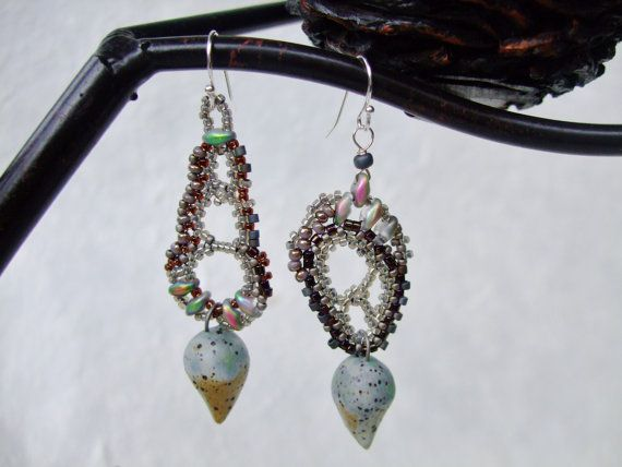 Check out this item in my Etsy shop https://www.etsy.com/listing/207518922/grey-brown-freeform-peyote-earrings-with