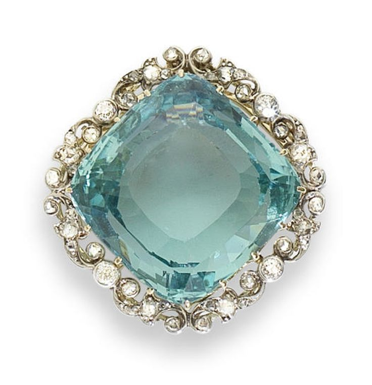 An aquamarine and diamond brooch/pendant, circa 1905  The square cushion-shaped faceted aquamarine, claw-set within a foliate frame of old brilliant and rose-cut diamonds, mounted in silver and gold, with detachable brooch fitting and articulated pendant loop, aquamarine approximately 56.00 carats, length 3.5cm, chain and screwdriver supplied, fitted case by Hancocks & Co, 9 Vigo Street, London, W.1
