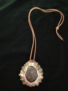 Limpet shell with porcelaine glaze and leather pendant