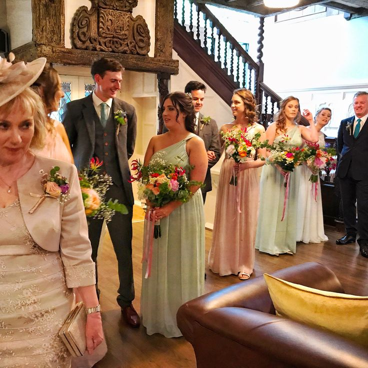 Pretty bridesmaids with bright bohemian bouquets at Laura Ashley The Manor, Hertfordshire