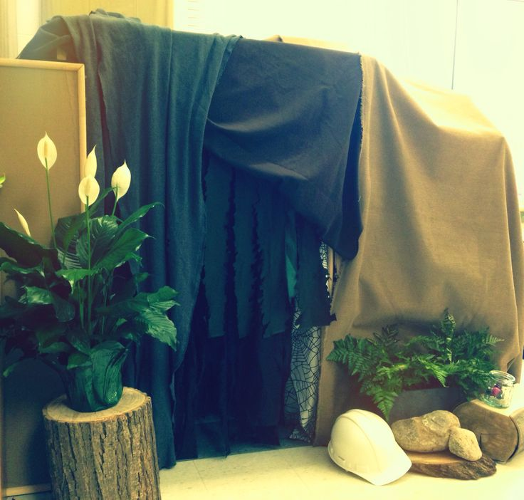 Cave made from puppet theatre, blankets, and cardboard boxes