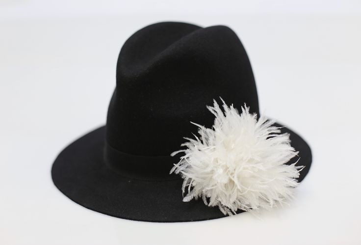 Black furfelt fedora with a white ostrich feather detail for a feminine touch.  #millinery #feathers #pompom #masculine #feminine #furfelt #ostrich #hat