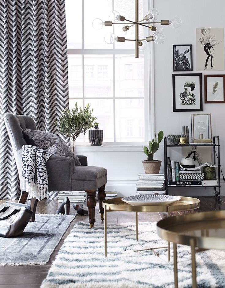 Modern living room in grey, white, black and brass accents.