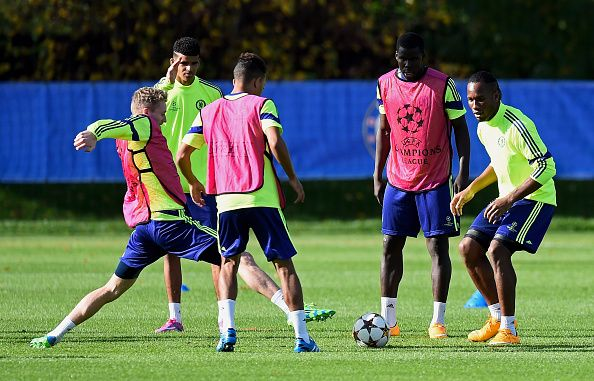 Andre Schuerrle (L) and Didier Drogba (R) of Chelsea warmup during the Chelsea FC training session ahead of the UEFA Champions League Group G match against NK Maribor at the Chelsea training ground on October 20, 2014 in Cobham, United Kingdom