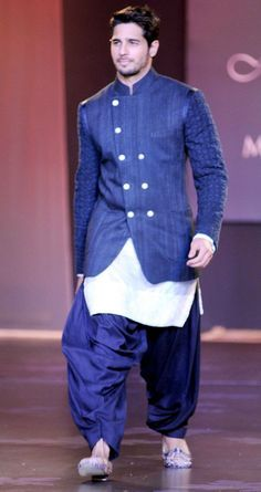 Sidharth Malhotra turned showstopper for designer Manish Malhotra at the Mijwan Fashion Show. #Style #Bollywood #Fashion #Handsome