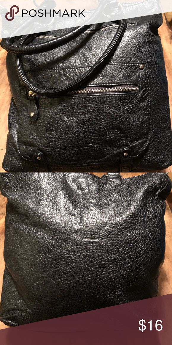 Black Leather Purse Previously used but well taken care of. black leather purse with two pockets in front, zipper pocket on inside and snap closure. Sturdy Double straps but no shoulder strap. Originally purchased at Target. Bags Shoulder Bags