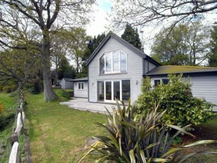 House in Storrington, United Kingdom. The Sanctuary is exactly that - a sanctuary! It boasts stunning views over the South Downs and is the perfect place to relax and enjoy the country air with friends and family.  This is a special house and we want you to love it as much as we do. T...