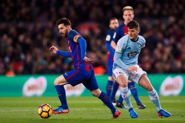 Lionel Messi (L) of FC Barcelona conducts the ball past Nemanja Radoja (R) of RC Celta de Vigo during the La Liga match between FC Barcelona and RC Celta de Vigo at Camp Nou stadium on March 4, 2017 in Barcelona, Catalonia.