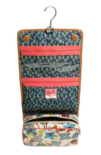 hanging travel toiletry bag! love the compartments and vintagey look.
