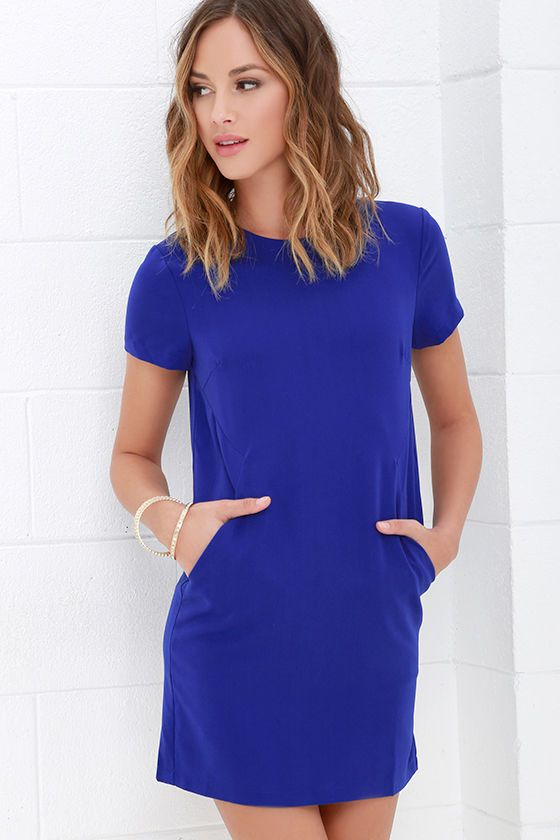 You're definitely starting your day off right when you step out the door in the Have a Good One Royal Blue Shift Dress! Darted bodice is framed by a rounded neckline and short sleeves, all made of medium-weight woven poly fabric. Angular seaming at the waist creates stealthy diagonal welted pockets above a relaxed, shift silhouette. Hidden back zipper and clasp.