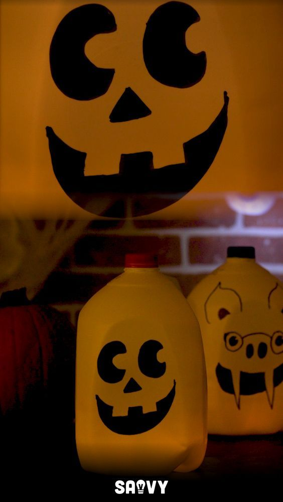 Create your own Halloween decorations for cheap! There's no need to spend a ton of money to decorate your house when you can make these super cute Milk Jug Ghosts. Not only are they cute, but they light up your sidewalk for all your little trick-or-treaters! #DecorateYourHomeIdeas