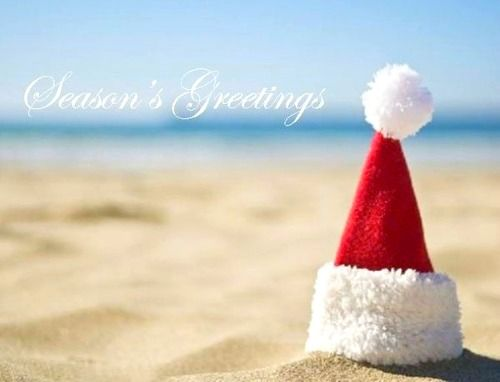 Santa Hat at the Beach. Featured on Beach Bliss Living: http://beachblissliving.com/beach-christmas-card-photo-ideas/