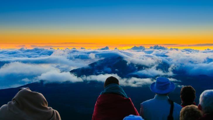 """Solopgang på toppen af """"Solens Hus"""" på toppen af den udslukte vulkan Haleakala"""