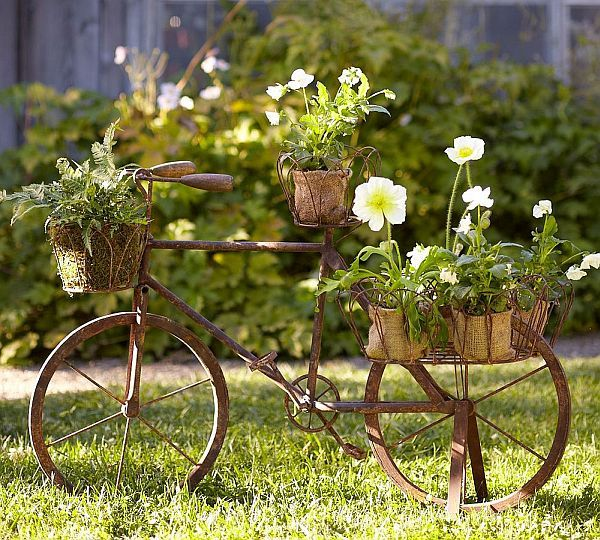 take some inspiration from this bicycle planter, which you could purchase from Pottery Barn (for $250; it's still available). But you, good reader, are the kind of person that makes stuff, and you could easily recreate something like this at home using an old bike, some inexpensive wire baskets, and a little paint.