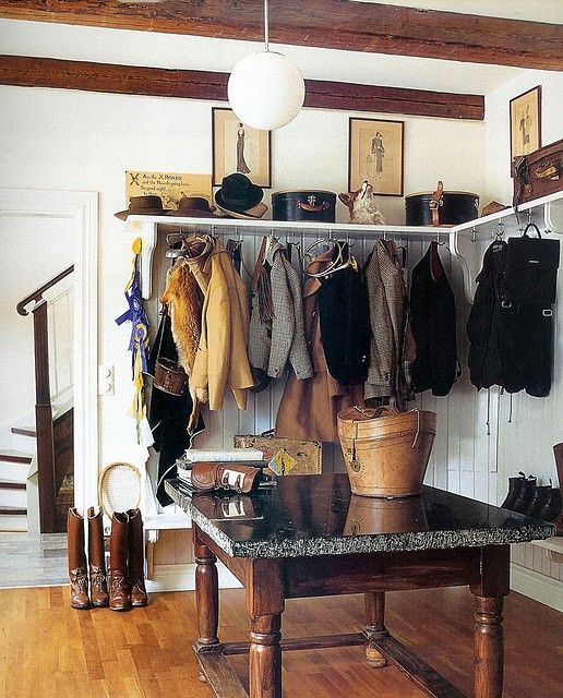Hold your horses...or horse gear...Equestrian chic entry way storage space for riding gear and boots...Design Chic: Still Loving Equestrian Chic...