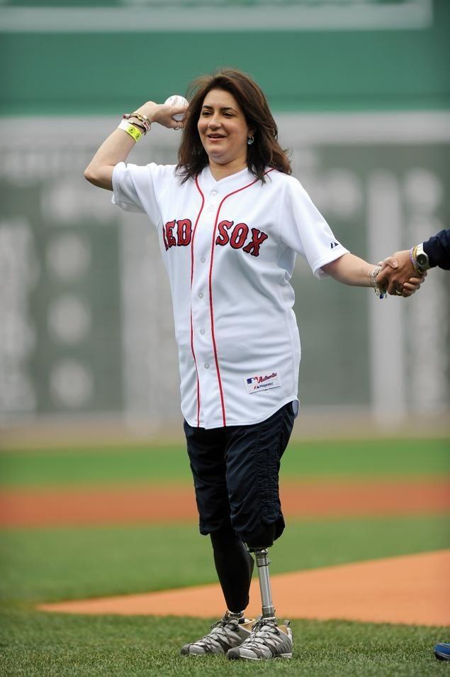 Boston Marathon victim, Celeste Cororan throws first pitch at Boston Red Sox game, reiterating the central theme of Boston Strong.