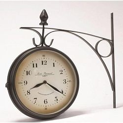 based on old clocks from european train stations this double sided clock is a perfect