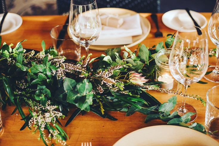 Australian wildflowers and foliage create a beautiful botanical tablescape at Harvest Newrybar for wedding of Gaby and Tim #weddingtable #weddinginspiration #wildflowers #byronbaywedding