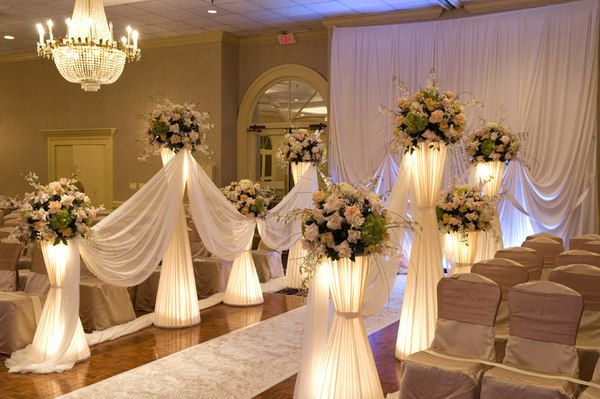This would be a neat idea for the wedding alter/ceremony. We could use taller pillars for the height and I like the lighting elements.