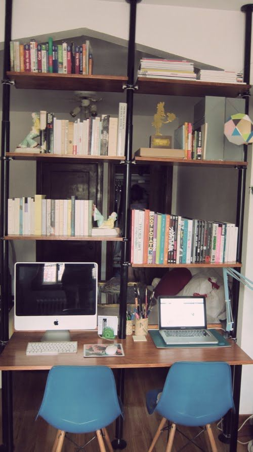 IKEA Hackers: Stolmen into mid-century unit/space-divider/desk - spray painted poles, put a back on the shelves so books won't fall through, shelves from a piece of old oak