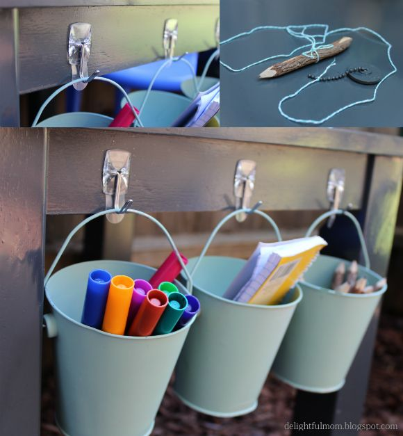 Great idea for art supply storage! Add hooks and buckets to the side of a kids table. Repainted DIY End Table Turned To Kids Table.