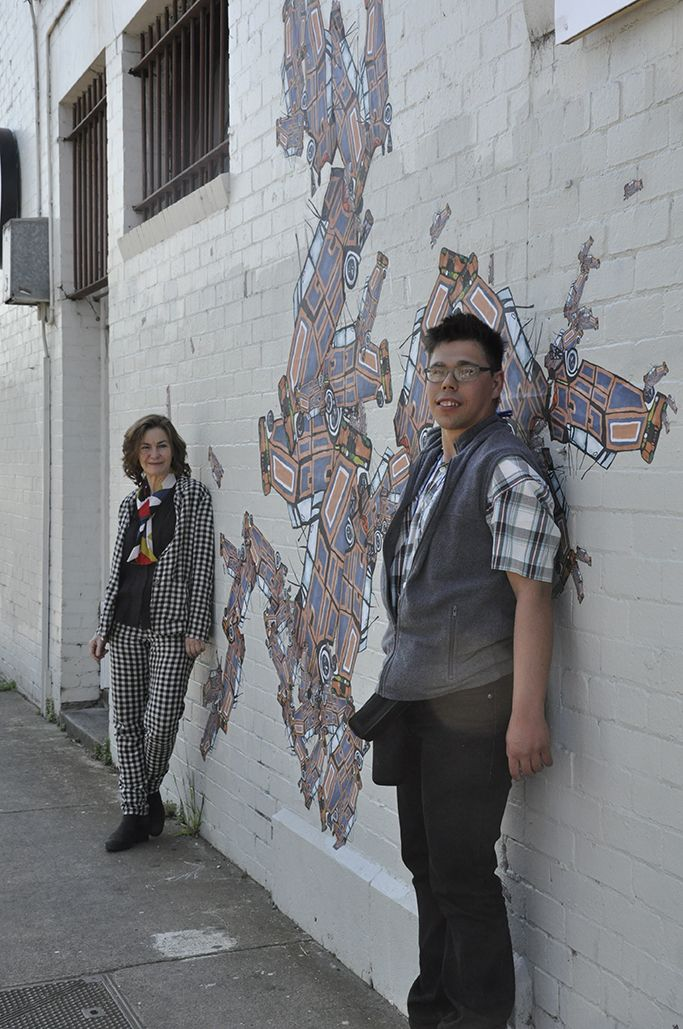 Annalea Beattie & Cam Noble in front of their 2015 public art installation 'Pile Up'.