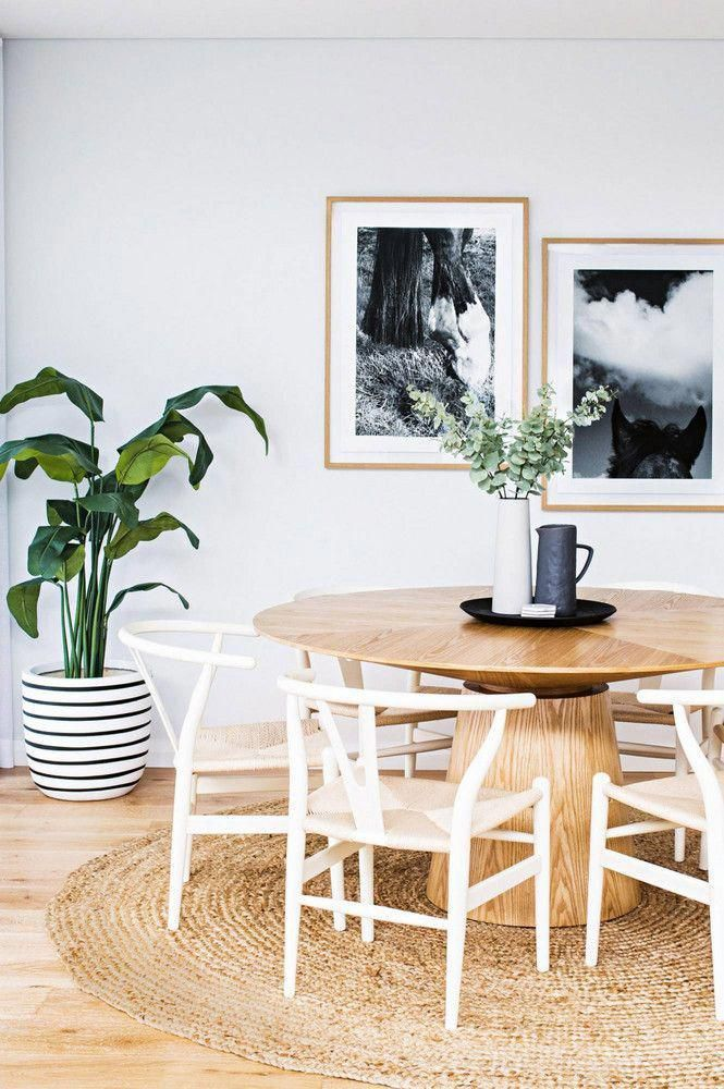 Dining Room With Tan Round Woven Rug White Wishbone Chairs Light Tan Wood Round Dining Table Round Dining Room Organic Dining Room Scandinavian Dining Room