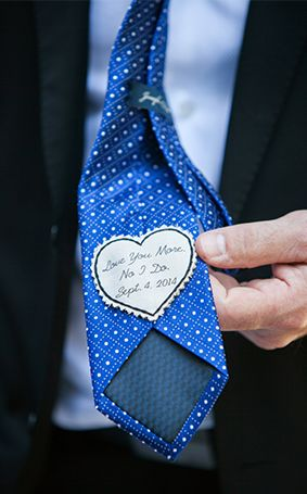Sew a sweet (and tiny) wedding day message on the groom's tie