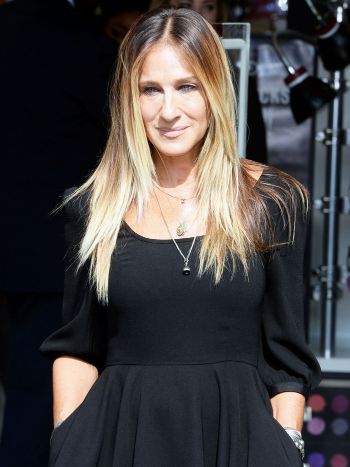 A simple centrally-parted, poker-straight hairdo works for Sarah Jessica Parker's face shape.
