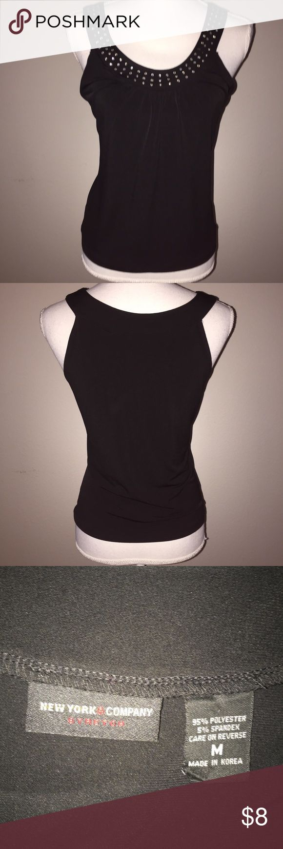 New York & Company Black Rhinestone-Adorned Top This lovey top from New York & Company is black with white rhinestone around the neckline. It is size M and is in excellent condition. If you have any questions, please ask! New York & Company Tops