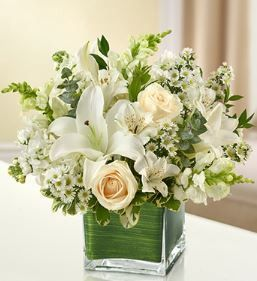 Healing Tears - All White Arrangement Elegant white flowers help to convey your love with graceful beauty that heals the soul. Our lovely cube vase arrangement is crafted from fresh roses, lilies, sna