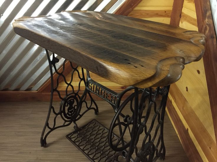 Rustic sewing machine table made from reclaimed barnwood.