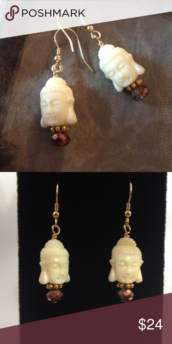 "Carved Buddha Head Earrings Gorgeous double sided Carved Buddha head with Faceted Crystals! 14K gold plated Earwires. 1 1/4 "". Includes rubber safety backs Jewelry Earrings"